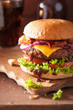 Bacon cheese burger with beef patty tomato onion cola.  Stock Image