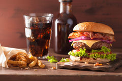 Bacon cheese burger with beef patty tomato onion cola Stock Images
