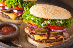 Bacon cheese burger with pickles tomato onion Stock Photography
