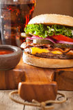 Bacon cheese burger with pickles tomato onion Royalty Free Stock Photography