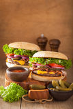 Bacon cheese burger with pickles tomato onion Stock Photos