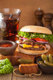 Bacon cheese burger with pickles tomato onion Royalty Free Stock Image