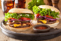 Bacon cheese burger with pickles tomato onion Stock Images