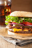 Bacon cheese burger with pickles tomato onion.  Royalty Free Stock Photos