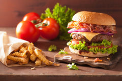 Bacon cheese hamburger with beef patty tomato onion Royalty Free Stock Images