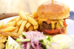 Bacon cheese hamburger with fries Stock Images