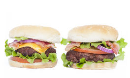 Bacon cheeseburger and Bacon Burger. With allthe fixings on white with copyspace Stock Photos