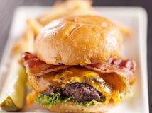 Bacon cheeseburger with extreme selective focus royalty free stock photos