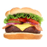 Bacon Cheeseburger Hamburger Isolated. A delicious looking bacon cheeseburger hamburger with lettuce, tomatoes, onions and pickles isolated on white background royalty free stock images