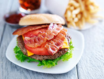 Bacon chesseburger with fries and cola Stock Images