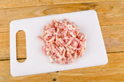Bacon on a chopping board Stock Photo