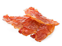 Bacon close-up on white stock photography