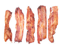 Bacon. Cooked slices of bacon isolated on white Royalty Free Stock Photos