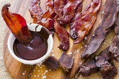 Bacon coperto di cioccolato fotografia stock