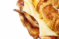 Bacon croissant. Slices of British bacon served in a croissant stock image