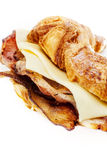 Bacon croissant. Slices of British bacon served in a croissant royalty free stock photography