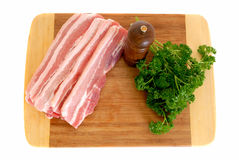Bacon on cutting board Stock Images