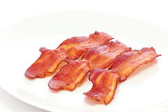 Bacon. Delicious plate of wavy bacon Stock Image