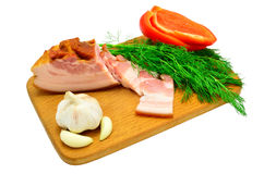 Bacon, dill, pepper and garlic on a board Stock Photos
