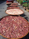 Bacon drying in the sun, Thailand. Royalty Free Stock Photo
