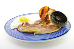 Bacon and Egg Breakfast on a Blue Plate Royalty Free Stock Image