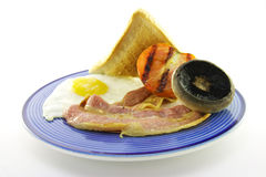 Bacon and Egg Breakfast on a Blue Plate Stock Photo
