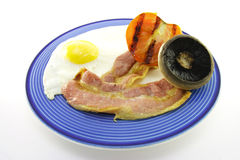 Bacon and Egg Breakfast on a Blue Plate Royalty Free Stock Photos