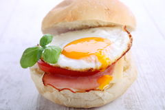 Bacon and egg bun. Royalty Free Stock Image