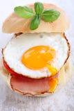 Bacon and egg bun. Stock Photo