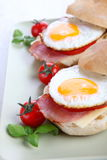 Bacon and egg bun. Bacon and egg bun on a white background Royalty Free Stock Image