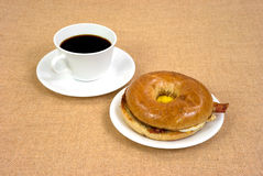 Bacon egg and cheese bagel and coffee Royalty Free Stock Photo