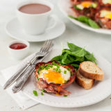 Bacon and Egg Cups with Spinach Royalty Free Stock Photography