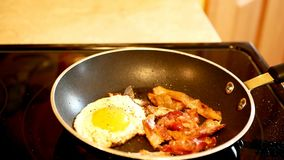 Bacon and Egg Frying in Hot Fry Pan in Close Up Clip with Selective Focus. stock video