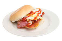 Bacon & Egg Roll. Bacon & fried egg roll with tomato ketchup Stock Photos