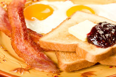 Bacon and Eggs. Along with toast and jelly for the perfect not so healthy breakfast Stock Images