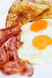 Bacon and Eggs. Breakfast of bacon and eggs with wholewheat toast.  Yummo Stock Images