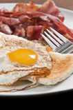 Bacon and eggs. On toast served on white plate stock photo