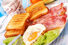 Bacon and eggs for breakfast. Bacon and eggs for english breakfast Royalty Free Stock Photo