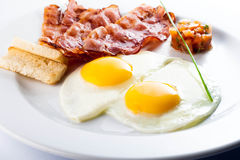 Bacon and eggs. Breakfast food stock photo
