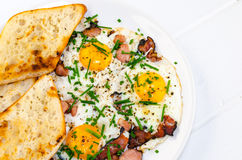 Bacon, eggs and chive with crispy toast Royalty Free Stock Images