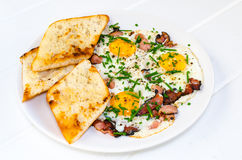 Bacon, eggs and chive with crispy toast Stock Images
