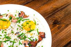 Bacon, eggs and chive with crispy toast Stock Photo