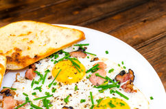 Bacon, eggs and chive with crispy toast Royalty Free Stock Photo
