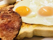 Bacon and eggs. Cooked breakfast with crispy bacon and fried eggs Royalty Free Stock Image
