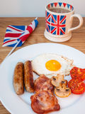 Bacon and eggs with cup of tea and british flag Royalty Free Stock Image