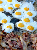 Bacon and Eggs. Frying on the barbeque for big breakfast stock photos