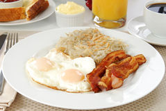 Bacon Eggs and Hash Browns. A breakfast of bacon, eggs and hash browns royalty free stock images