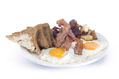 bacon eggs hash browns and toast Royalty Free Stock Image