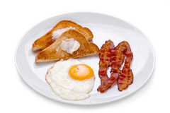 Bacon, Eggs and Toast. Breakfast on white plate on white background Royalty Free Stock Image