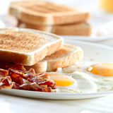Bacon, eggs and toast breakfast Stock Images